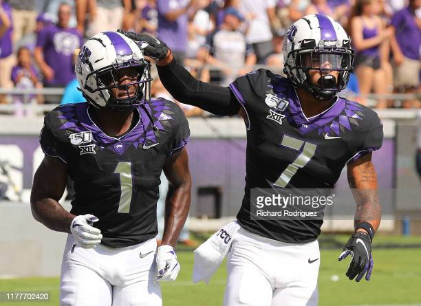 Wide receiver Jalen Reagor and John Stephens Jr #7 of the TCU Horned Frogs celebrate a first quarter touchdown against the Kansas Jayhawks at Amon G...