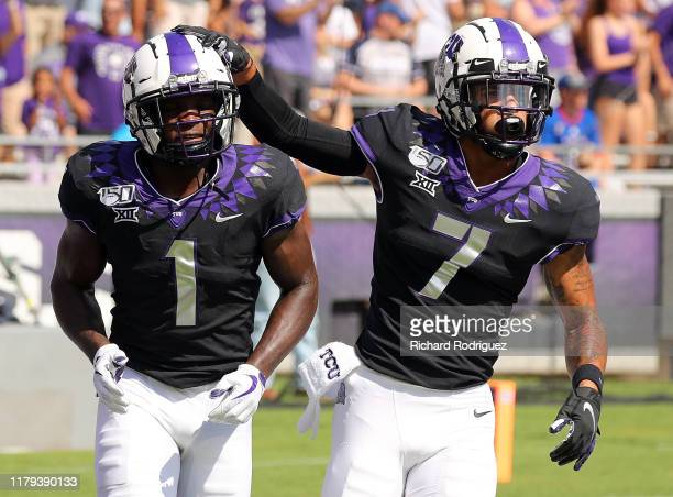 Wide receiver Jalen Reagor of the TCU Horned Frogs and wide receiver John Stephens Jr #7 of the TCU Horned Frogs celebrate a touchdown against the...