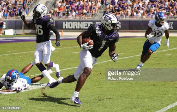 Wide receiver Jalen Reagor of the TCU Horned Frogs carries the ball against the Kansas Jayhawks at Amon G Carter Stadium on September 28 2019 in Fort...