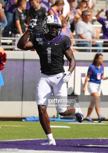 Wide receiver Jalen Reagor of the TCU Horned Frogs celebrates a touchdown against the Kansas Jayhawks at Amon G Carter Stadium on September 28 2019...