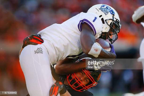 Wide receiver Jalen Reagor of the TCU Horned Frogs gets brought down on a 10yard catch for a first down by safety Malcolm Rodriguez of the Oklahoma...