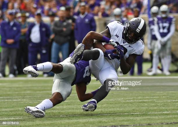 Wide receiver Jalen Reagor of the TCU Horned Frogs gets tackled after catching a pass against defensive back Duke Shelley of the Kansas State...