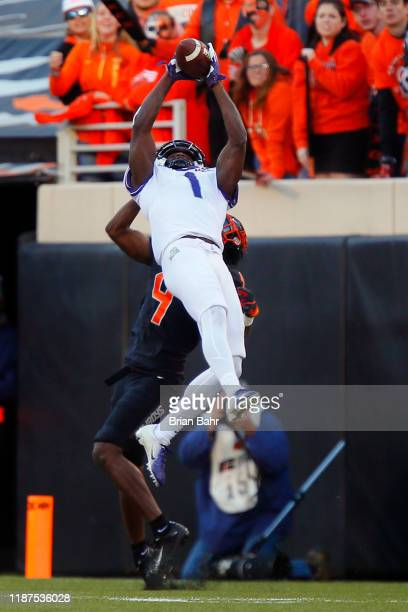 Wide receiver Jalen Reagor of the TCU Horned Frogs pulls down a 30yard catch against cornerback AJ Green of the Oklahoma State Cowboys at the nine...