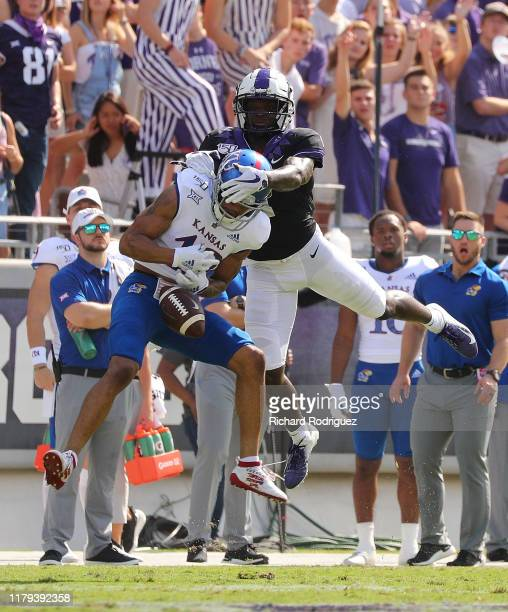 Wide receiver Jalen Reagor of the TCU Horned Frogs tries to prevent and interception by cornerback Hasan Defense of the Kansas Jayhawks at Amon G...