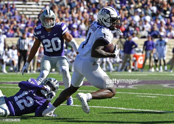 Wide receiver Jalen Reagor of the TCU Horned Frogs turns up field against defensive back AJ Parker of the Kansas State Wildcats during the first half...