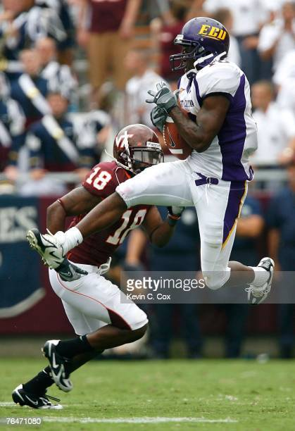 Wide receiver Jamar Bryant of the East Carolina Pirates pulls in a reception against cornerback Brandon Flowers of the Virginia Tech Hokies during...