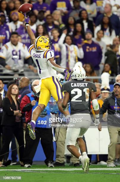 Wide receiver Ja'Marr Chase of the LSU Tigers can't make a catch while being defended by defensive back Rashard Causey of the UCF Knights during the...