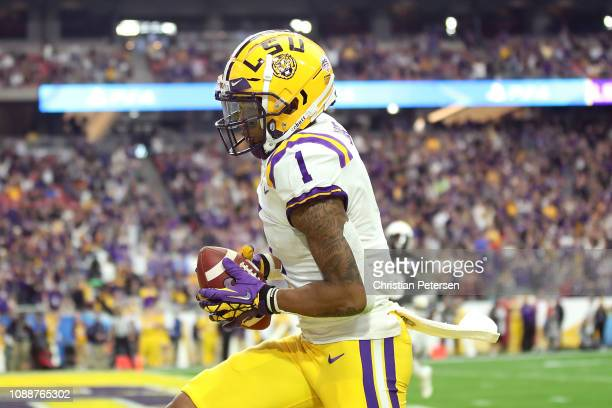 Wide receiver Ja'Marr Chase of the LSU Tigers catches a 32yard touchdown pass during the third quarter of the PlayStation Fiesta Bowl between LSU and...