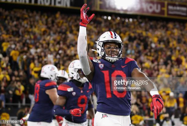 Wide receiver Jamarye Joiner of the Arizona Wildcats celebrates after scoring on a 48 yard touchdown reception against the Arizona State Sun Devils...