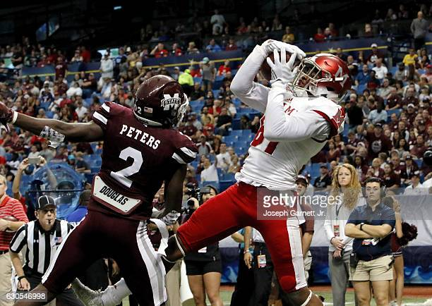 Wide receiver James Gardner of the Miami Redhawks pulls in a touchdown catch over defensive back Jamal Peters of the Mississippi State Bulldogs...