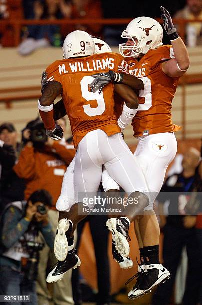 Wide receiver James Kirkendoll of the Texas Longhorns celebrates his touchdown with Malcolm Williams and Greg Smith at Darrell K Royal-Texas Memorial...