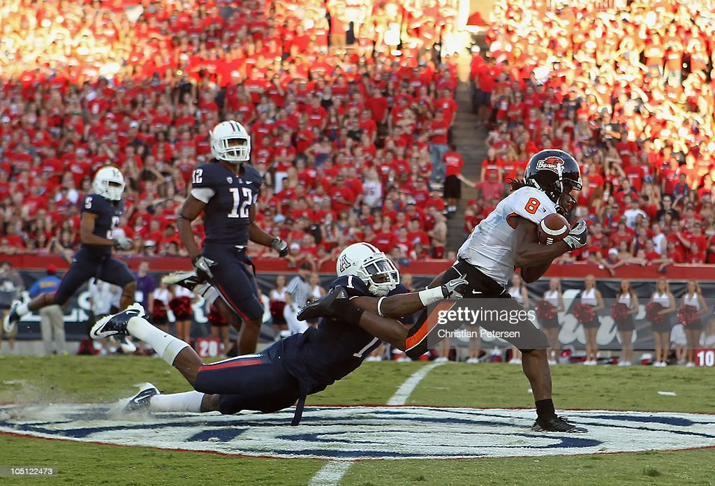 Wide receiver James Rodgers #8 of the Oregon State Beavers runs with the ball after a reception past Robert Golden #1 of the Arizona Wildcats during the second quarter of the college football game at Arizona Stadium on October 9, 2010 in Tucson, Arizona.