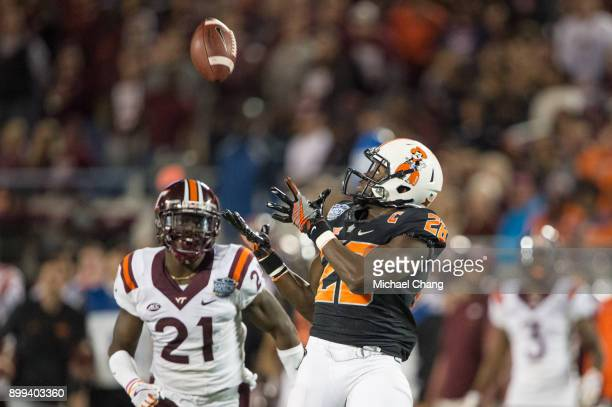 Wide receiver James Washington of the Oklahoma State Cowboys looks to catch a pass in front of safety Reggie Floyd of the Virginia Tech Hokies on...