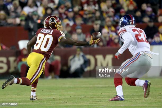 Wide receiver Jamison Crowder of the Washington Redskins makes a catch in front of free safety Darian Thompson of the New York Giants in the first...