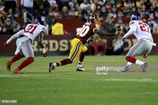 Wide receiver Jamison Crowder of the Washington Redskins makes a catch in front of Landon Collins and Darian Thompson of the New York Giants in the...