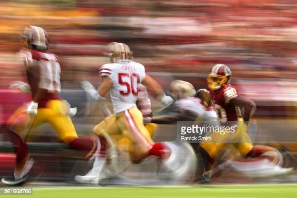 Wide receiver Jamison Crowder of the Washington Redskins rushes in front of linebacker Brock Coyle of the San Francisco 49ers during the first...