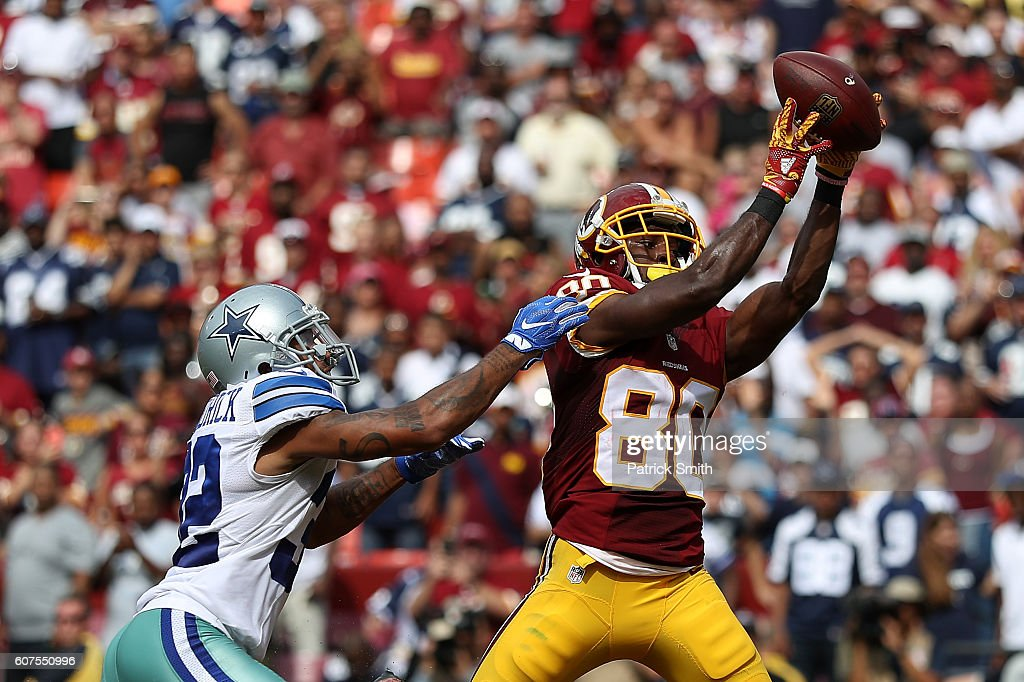 Wide receiver Jamison Crowder #80 of the Washington Redskins scores a third quarter touchdown past cornerback Orlando Scandrick #32 of the Dallas Cowboys at FedExField on September 18, 2016 in Landover, Maryland.