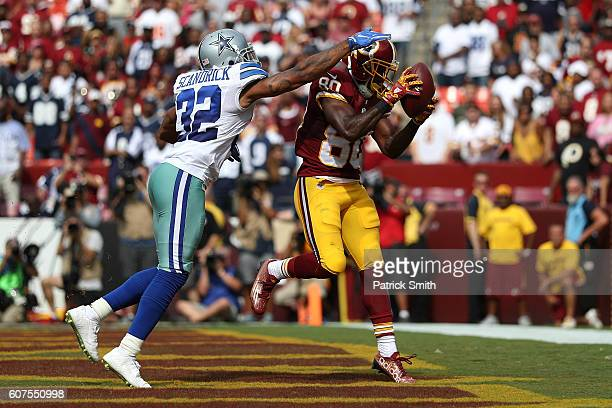 Wide receiver Jamison Crowder of the Washington Redskins scores a third quarter touchdown past cornerback Orlando Scandrick of the Dallas Cowboys at...