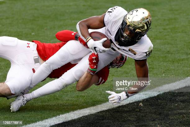 Wide receiver Jaquarii Roberson of the Wake Forest Demon Deacons scores a touchdown against safety Scott Nelson of the Wisconsin Badgers following a...
