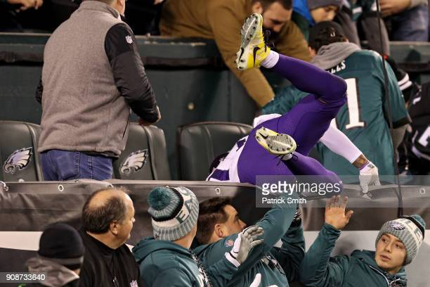 Wide receiver Jarius Wright of the Minnesota Vikings crashes into the stands after missing a reception against the Philadelphia Eagles in the fourth...