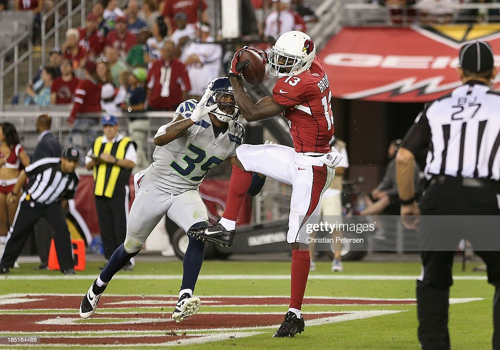 Wide receiver Jaron Brown #13 of the Arizona Cardinals catches a 8 yard touchdown reception past cornerback Brandon Browner #39 of the Seattle Seahawks during the fourth quarter of the NFL game at the University of Phoenix Stadium on October 17, 2013 in Glendale, Arizona. The Seahawks defeated the Cardinals 34-22.