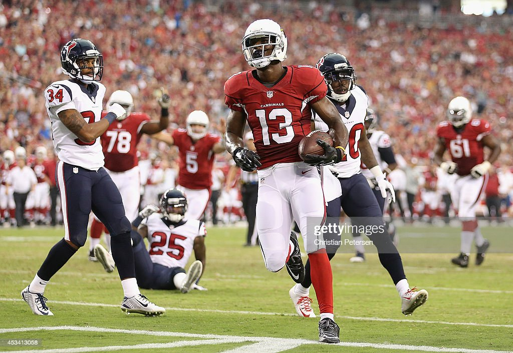 Wide receiver Jaron Brown #13 of the Arizona Cardinals scores a 5 yard touchdown reception against the Houston Texans during the first quarter of the preseason NFL game at the University of Phoenix Stadium on August 9, 2014 in Glendale, Arizona.