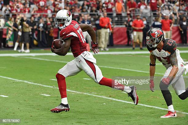 Wide receiver Jaron Brown of the Arizona Cardinals slips past safety Chris Conte of the Tampa Bay Buccaneers for a touchdown during the second...