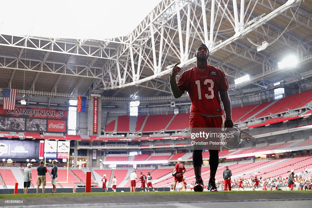 Wide receiver Jaron Brown #13 of the Arizona Cardinals walks off the field following the team training camp at University of Phoenix Stadium on August 2, 2015 in Glendale, Arizona.