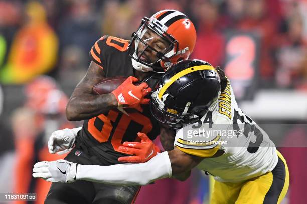 Wide receiver Jarvis Landry of the Cleveland Browns catches a pass as he is hit by strong safety Terrell Edmunds of the Pittsburgh Steelers in the...