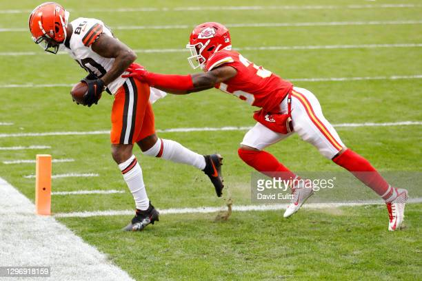Wide receiver Jarvis Landry of the Cleveland Browns completes a pass for a touchdown over cornerback Charvarius Ward of the Kansas City Chiefs during...