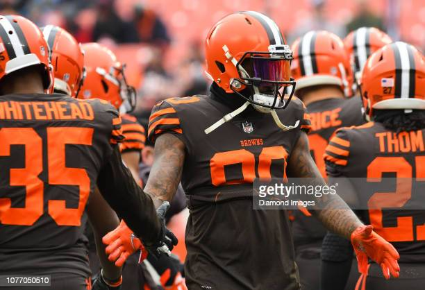 Wide receiver Jarvis Landry of the Cleveland Browns highfives defensive back Jermaine Whitehead prior to a game against the Cincinnati Bengals on...