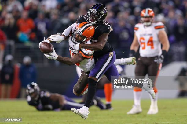 Wide Receiver Jarvis Landry of the Cleveland Browns is tackled after a reception by cornerback Tavon Young of the Baltimore Ravens in the fourth...