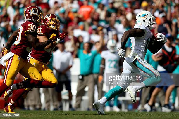 Wide receiver Jarvis Landry of the Miami Dolphins carries the ball for a second half touchdown during a game against the Washington Redskins at...