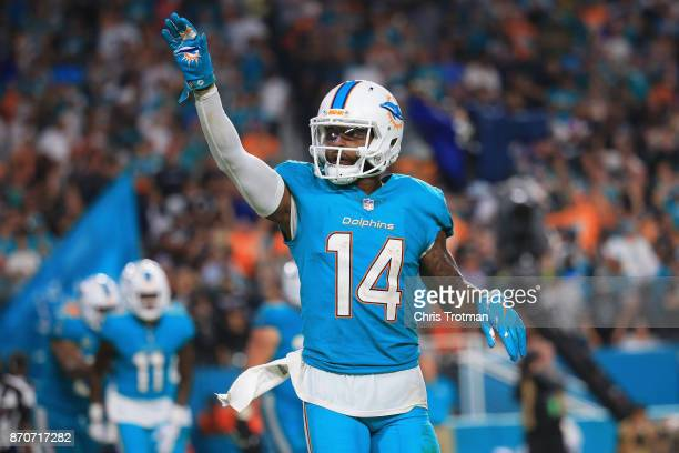 Wide receiver Jarvis Landry of the Miami Dolphins celebrates a touchdown in the third quarter at Hard Rock Stadium on November 5 2017 in Miami...