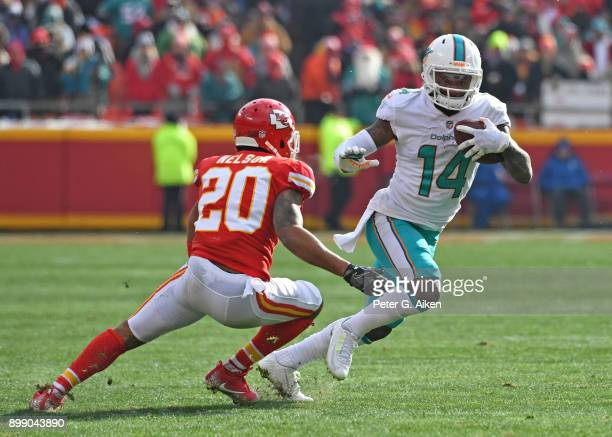 Wide receiver Jarvis Landry of the Miami Dolphins runs up field after catching a pass against cornerback Steven Nelson of the Kansas City Chiefs...