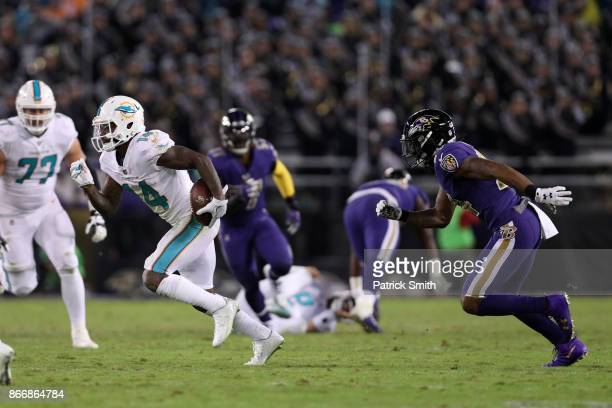 Wide Receiver Jarvis Landry of the Miami Dolphins runs with the ball in the fourth quarter against the Baltimore Ravens at MT Bank Stadium on October...