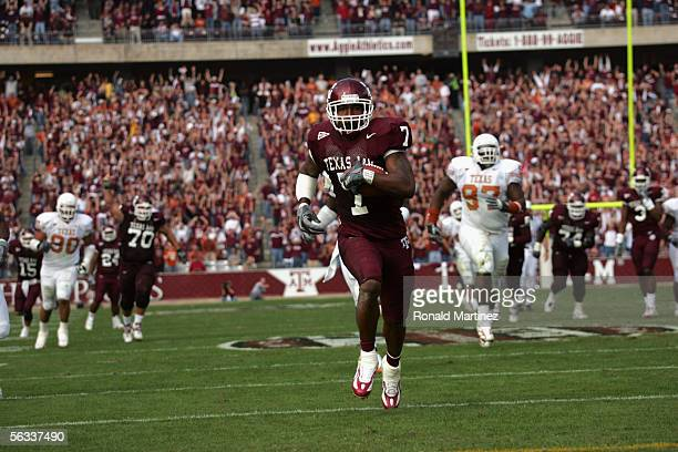 Wide receiver Jason Carter of the Texas AM Aggies carries the ball against the Texas Longhorns at Kyle Field on November 25 2005 in College Station...