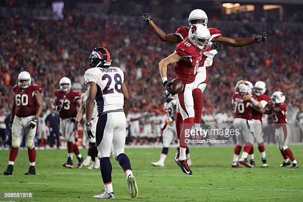 Wide receiver Jaxon Shipley and Marquis Bundy of the Arizona Cardinals celebrate after Shipley caught a 14 yard touchdown reception against the...