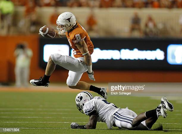 Wide receiver Jaxon Shipley of the Texas Longhorns hurdles defensive back Joe Sampson of the BYU Cougars in the fourth quarter on September 10, 2011...