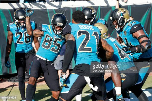 Wide Receiver Jaydon Mickens of the Jacksonville Jaguars celebrates after running back a punt return back for a touchdown with teammates during the...