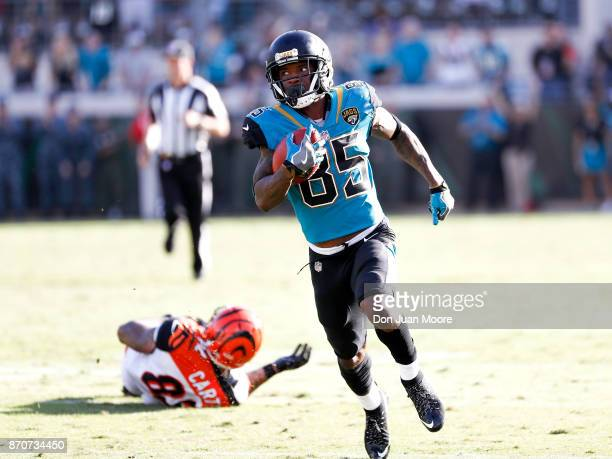 Wide Receiver Jaydon Mickens of the Jacksonville Jaguars runs a punt return back for a touchdown during the game against the Cincinnati Bengals at...