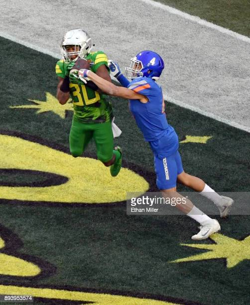 Wide receiver Jaylon Redd of the Oregon Ducks catches an eightyard pass in the end zone for a touchdown against cornerback DeAndre Pierce of the...
