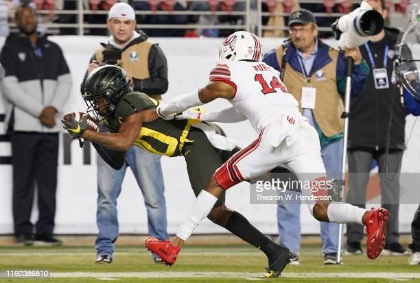 Wide receiver Jaylon Redd of the Oregon Ducks gets pushed out of bounds at the three yard line by defensive back Josh Nurse of the Utah Utes during...