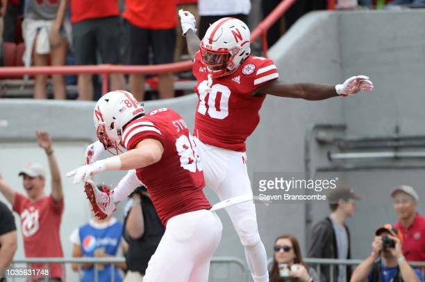 Wide receiver JD Spielman of the Nebraska Cornhuskers and tight end Jack Stoll celebrate a touchdown against the Colorado Buffaloes at Memorial...