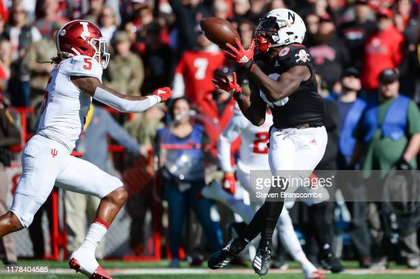 Wide receiver JD Spielman of the Nebraska Cornhuskers catches a pass against defensive back Juwan Burgess of the Indiana Hoosiers at Memorial Stadium...