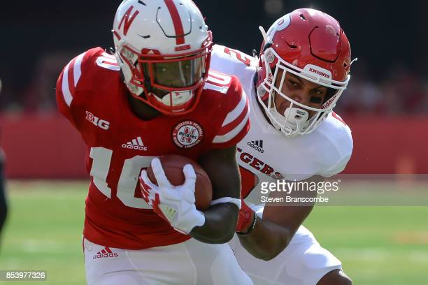 Wide receiver JD Spielman of the Nebraska Cornhuskers escapes the tackle of defensive back Kiy Hester of the Rutgers Scarlet Knights at Memorial...