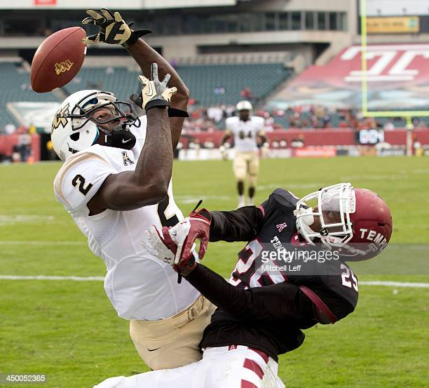 Wide receiver Jeff Godfrey of the University of Central Florida Knights drops a pass with cornerback Tavon Young of the Temple University Owls...