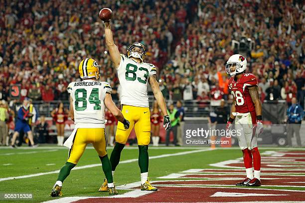 Wide receiver Jeff Janis of the Green Bay Packers celebrates after making an eightyard touchdown catch alongside teammate wide receiver Jared...