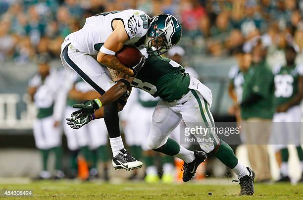 Wide receiver Jeff Maehl of the Philadelphia Eagles catches a pass and is tackled by cornerback LeQuan Lewis of the New York Jets in the preseason...