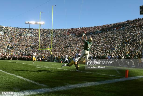 Wide receiver Jeff Samardzija of the University of Notre Dame Fighting Irish makes a catch near cornerback Justin Wyatt of the University of Southern...